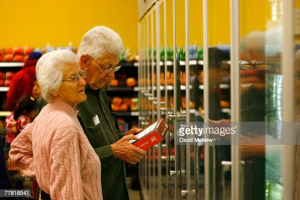 Shoppers browse the frozen foods section at a Fresh Easy grocery as Tesco PLC the UK's biggest retailer officially enters the US market opening its...