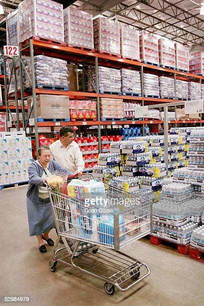 Shoppers browse the merchandise selection at a Costco Store May 26 2005 in Chicago Illinois Costco reported today an increase of six percent in third...