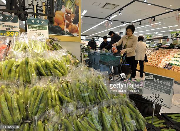 Shoppers buy vegetables at a supermarket in Tokyo on April 5 2011 after the government ordered a halt to shipments of vegetables form Chiba...