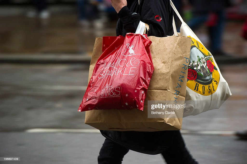 Shoppers carry bags of shopping on November 24, 2012 in London, England. Oxford Street was closed today to traffic for its annual pedestrian only Christmas Shopping.