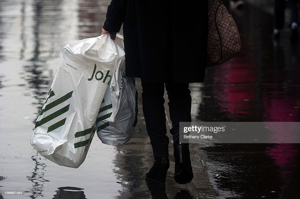 Shoppers carry bags of shopping on November 24, 2012 in London, England. Oxford Street was closed to traffic for its annual pedestrian only Christmas Shopping.