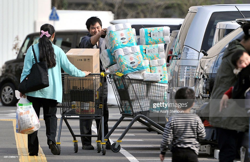 Shoppers carry the purchased huge amount of toilet rolls at the final weekend before the eight percent consumption tax is applied on March 29, 2014 in Fuchu, Tokyo, Japan. Japan raises consumption tax from 5 to 8 percent on April 1, and possibly to 10 percent in October 2015, despite market concerns about a slowing of the economic recovery.
