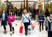 Shoppers carry their bags as they take advantage of Black Friday deals at Somerset Collection shopping mall on November 29 2013 in Troy Michigan...