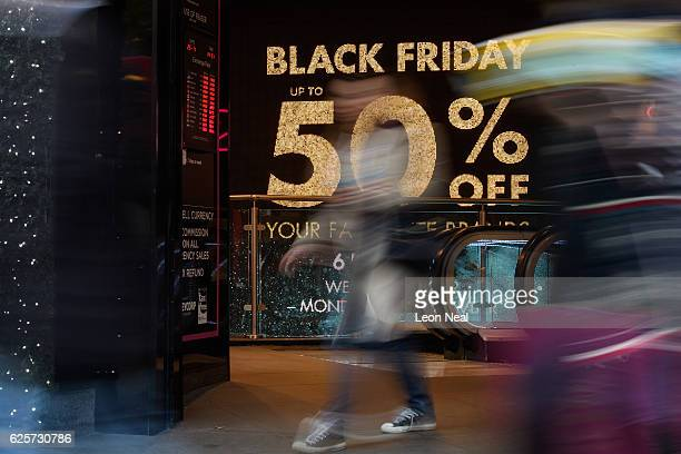 Shoppers carry their purchases on Oxford Street as stores offer discounted items in their 'Black Friday' sales on November 25 2016 in London England...