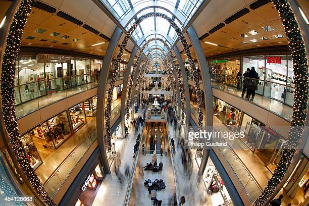 Shoppers carrying shopping bags walk through the 'Europa Passage' mall on December 7 2013 in Hamburg Germany According to a recent study people in...