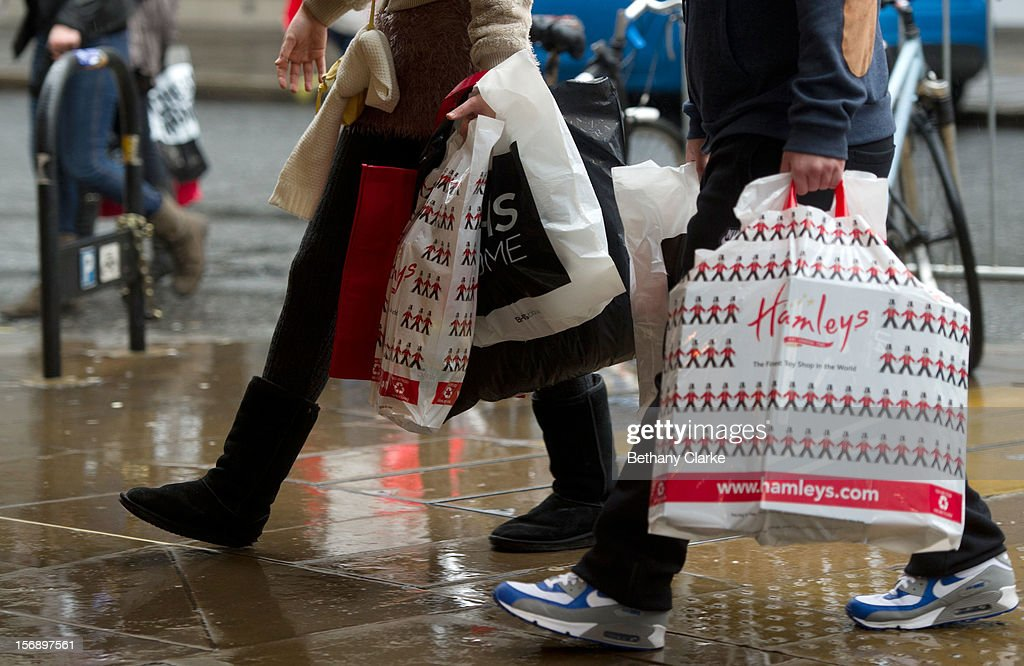 Shoppers carying shopping bags on Oxford Street on November 24, 2012 in London, England. Oxford Street was closed to traffic for its annual pedestrian only Christmas Shopping.