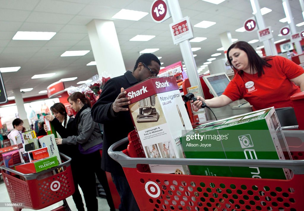 Shoppers check out during Black Friday sales at Target in the South Shore Plaza on November 23, 2012 in Braintree, Massachusetts. Black Friday, the start of the holiday shopping season, has traditionally been the busiest shopping day in the United States.