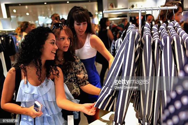 Shoppers check out the merchandise on opening day of the first local H M outlet on March 11 in Tel Aviv Israel HM the world's thirdbiggest clothing...