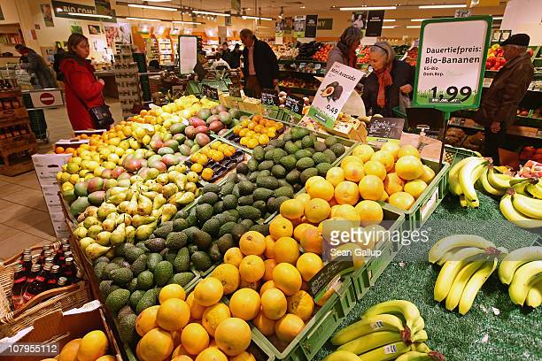 Shoppers chose from organic fruits and vegetables at a branch of German organic grocery store chain Bio Company on January 10 2011 in Berlin Germany...