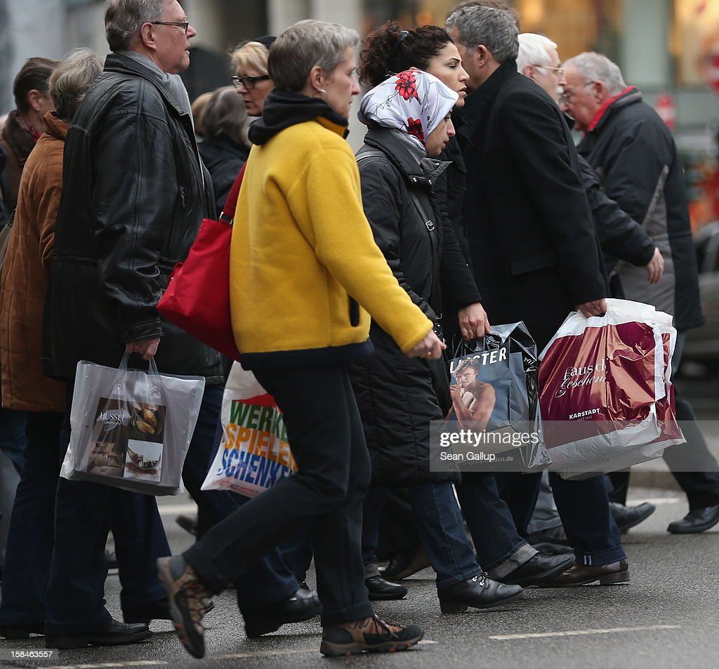 Shoppers cross a street in Steglitz district on December 17, 2012 in Berlin, Germany. Retailers are hoping for a strong Christmas season in Germany, one of the few countries whose economy has so far weathered the current Eurozone debt crisis relatively well.