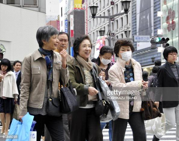 Shoppers cross road at Tokyo's Ginza district on November 16 2009 Japan's economy grew at the fastest pace in two and a half years in the third...