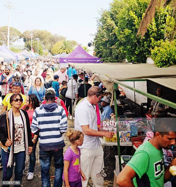 Shoppers crowd market stalls at CapeTown suburban street festival
