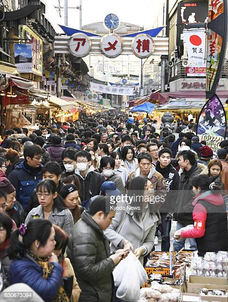 Shoppers crowd the Ameyoko market in Tokyo's Ueno area on Dec 29 to buy food for the New Year holidays