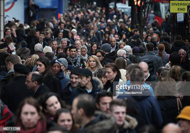 Shoppers crowd the pavement in Oxford Street on December 20 2014 in London England Shoppers in the United Kingdom are expected to spend £12 billion...
