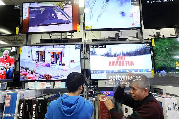 Shoppers decide on televisions at a Best Buy on November 26 2015 in San Diego California Although Black Friday sales are expected to be strong many...