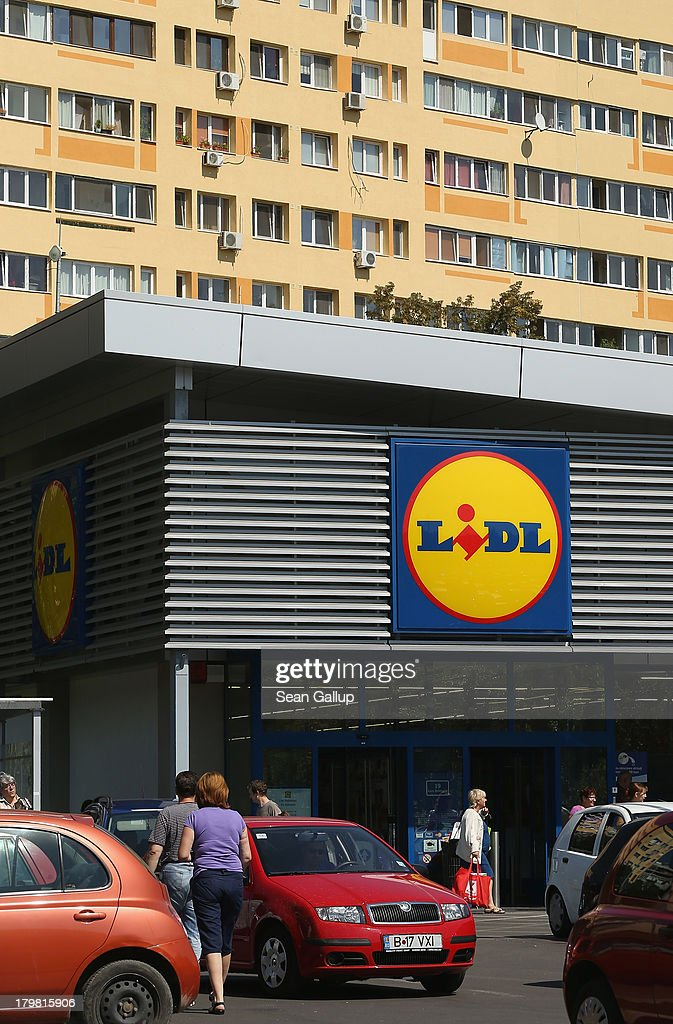 Shoppers emerge from a Lidl discount grocery store on September 7, 2013 in Bucharest, Romania. While Romania's economic output has risen significantly since it joined the European Union in 2007, it still lags in infrastructure development and the fight against corruption.
