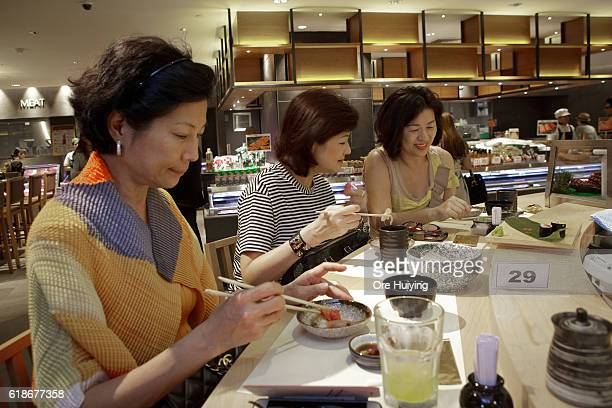Shoppers enjoy sushi at the casual dining area Noren in ISETAN The Japan Store Kuala Lumpur LGF THE MARKET experience the seasonal flavors section on...