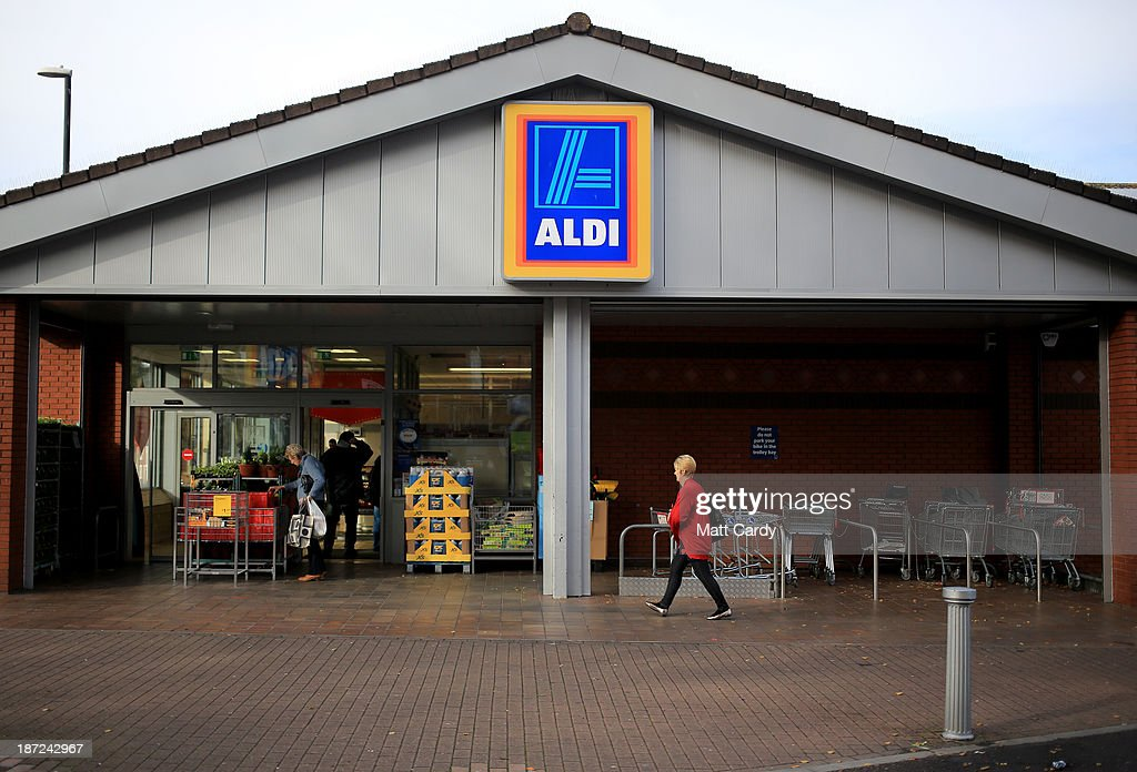 Shoppers enter a branch of the budget supermarket Aldi on November 7, 2013 in Bristol, England. As the German chain opens its 500th store in the affluent Bury St Edmunds, some retail experts are claiming that the low-cost supermarket is trying to attract more affluent shoppers, in particular by offering large discounts on luxury items.