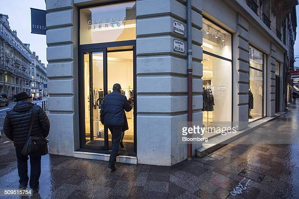 Shoppers enter a Claudie Pierlot luxury clothing store operated by SMCP Group in Toulouse France on Wednesday Feb 10 2016 Shandong Ruyi Group the...