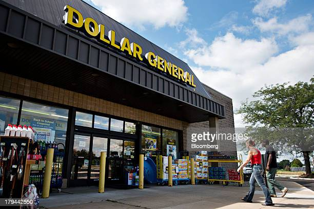 Shoppers enter a Dollar General Corp store in Ottawa Illinois US on Tuesday Sept 3 2013 Dollar General Corp is scheduled to release earnings figures...