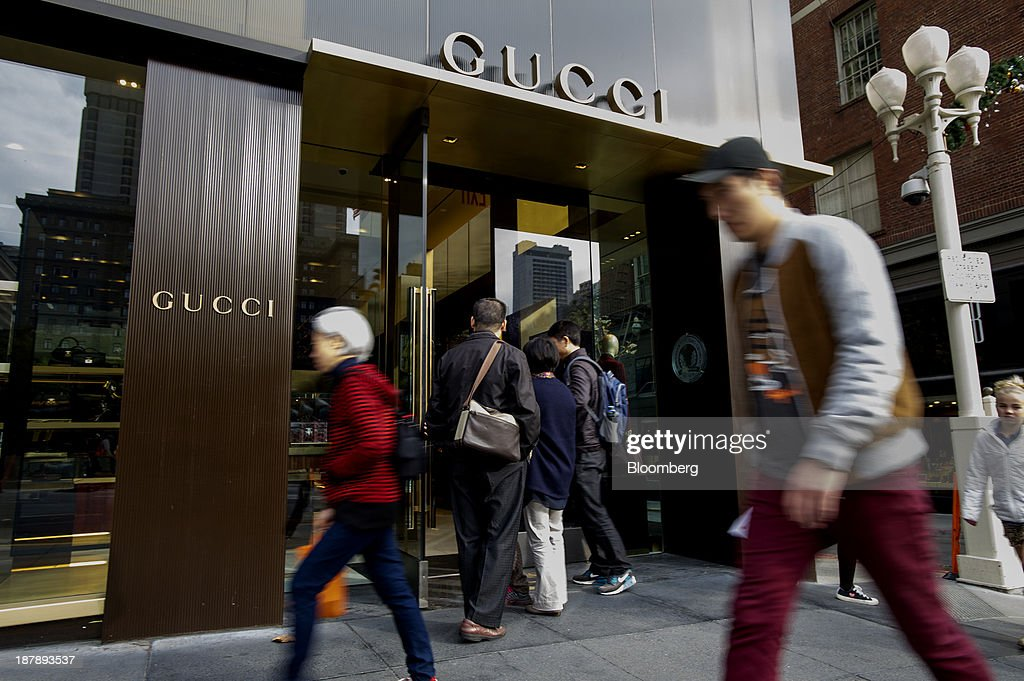 Shoppers enter a Gucci Group NV store in San Francisco, California, U.S., on Monday, Nov. 11, 2013. The Bloomberg Consumer Comfort Index is scheduled to be released on Nov. 14. Photographer: David Paul Morris/Bloomberg via Getty Images