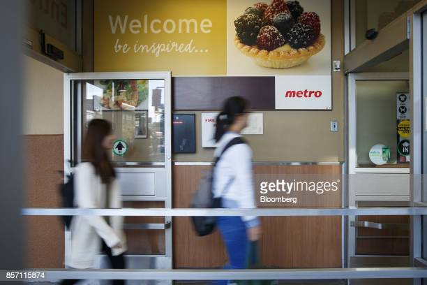Shoppers enter a Metro Inc grocery store in Toronto Ontario Canada on Monday Oct 2 2017 Canadian grocer Metro Inc agreed to buy pharmacy chain Jean...