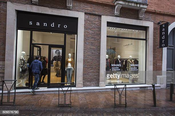 Shoppers enter a Sandro luxury clothing store operated by SMCP Group in Toulouse France on Wednesday Feb 10 2016 Shandong Ruyi Group the Chinese...