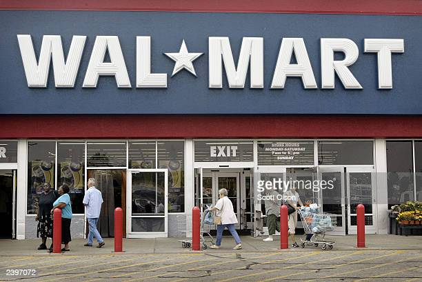 Shoppers enter a WalMart store August 13 2003 in Riverside Illinois WalMart Stores Inc reported strong second quarter results due in part to an...