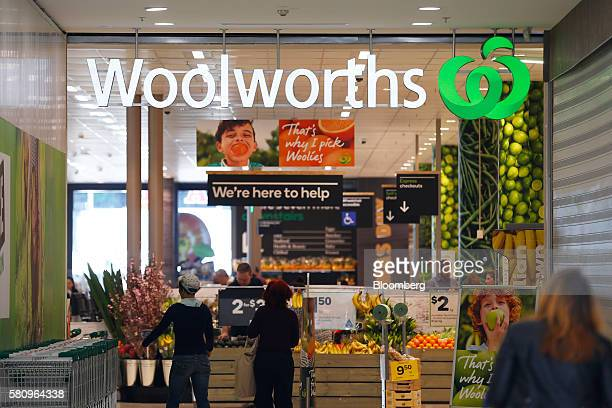 Shoppers enter a Woolworths Ltd supermarket in Sydney Australia on Tuesday July 26 2016 Woolworths Chief Executive Officer Brad Banducci pledged to...