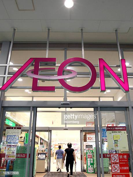 Shoppers enter an Aeon Co shopping center in Tokyo Japan on Wednesday July 7 2010 Aeon Co will book a gain of 181billion yen in the fiscal year...