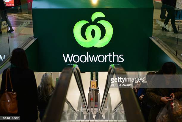 Shoppers enter and leave a Woolworths store in Sydney on August 29 2014 Australian supermarket giant Woolworths posted an 85 percent rise in its...