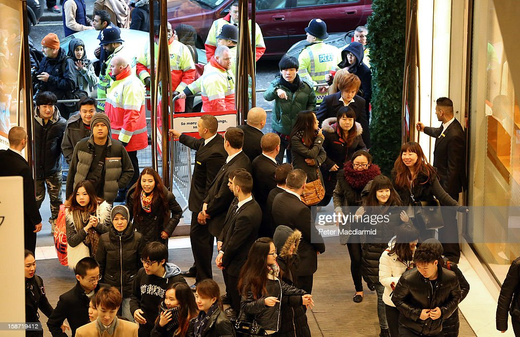 Shoppers enter Selfridges department store as their boxing Day sale begins on December 26, 2012 in London, England. Thousands of shoppers are in London looking for a bargain in the traditional Boxing Day sales.