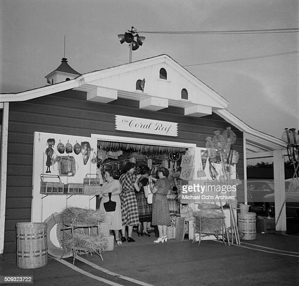 Shoppers enter the Coral Reef shop at the farmers market in Los AngelesCalifornia'n