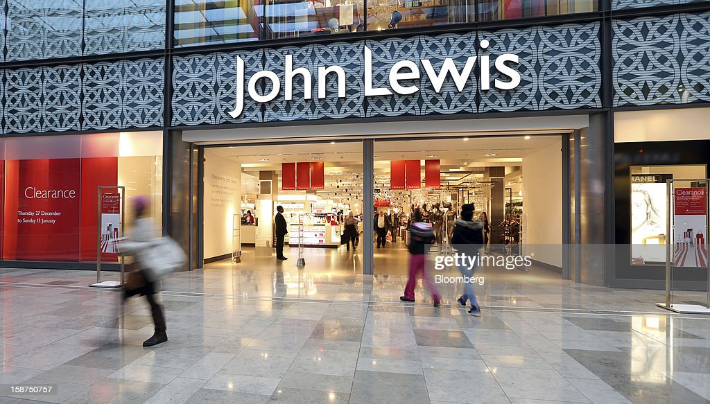 Shoppers enter the John Lewis Plc department store at the Westfield Stratford City shopping mall in London, U.K., on Thursday, Dec. 27, 2012. Overall Christmas shopping in the U.K. was similar to last year, according to the British Retail Consortium. Photographer: Chris Ratcliffe/Bloomberg via Getty Images