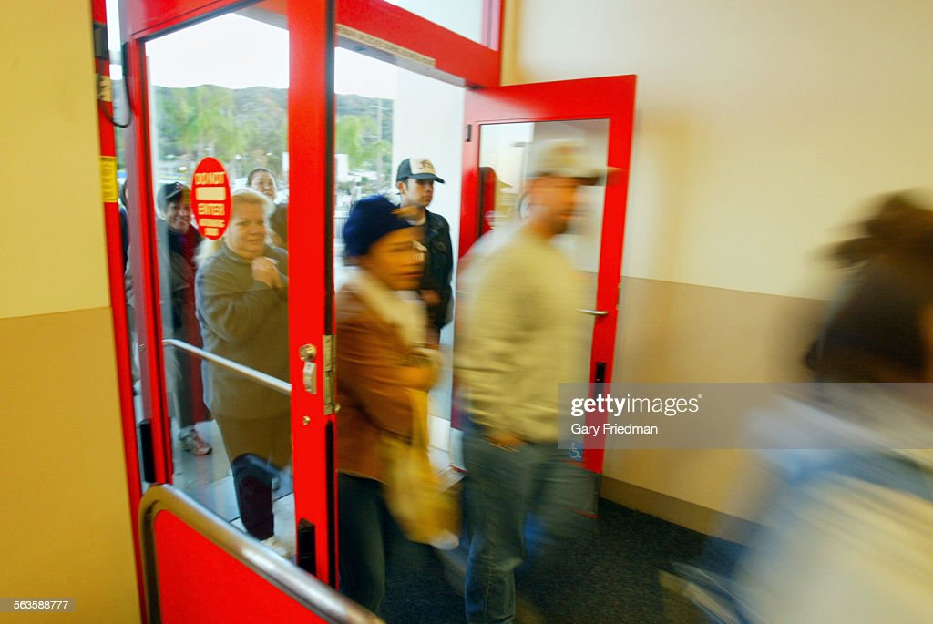 Open Store Doors shoppers enter the target store in eagle rock as doors open at 7