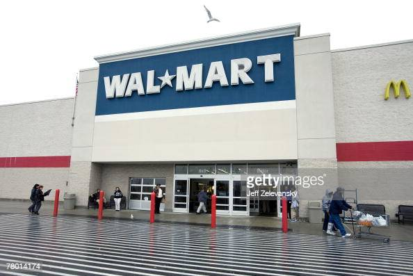 Shoppers enter the WalMart store November 20 2007 in Secaucus New Jersey The holiday shopping season 'officially' starts Friday after Thanksgiving...