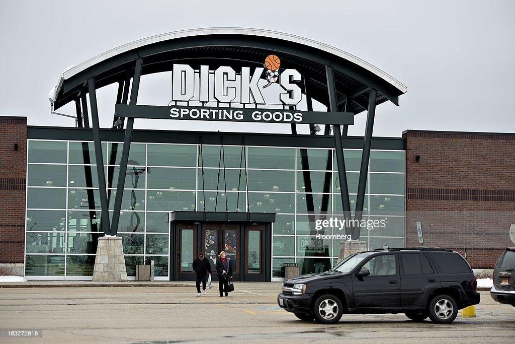 Shoppers exit a Dick's Sporting Goods Inc. store in Peoria, Illinois, U.S., on Wednesday, March 6, 2013. Dick's Sporting Goods is expected to release earnings data on March 11. Photographer: Daniel Acker/Bloomberg via Getty Images