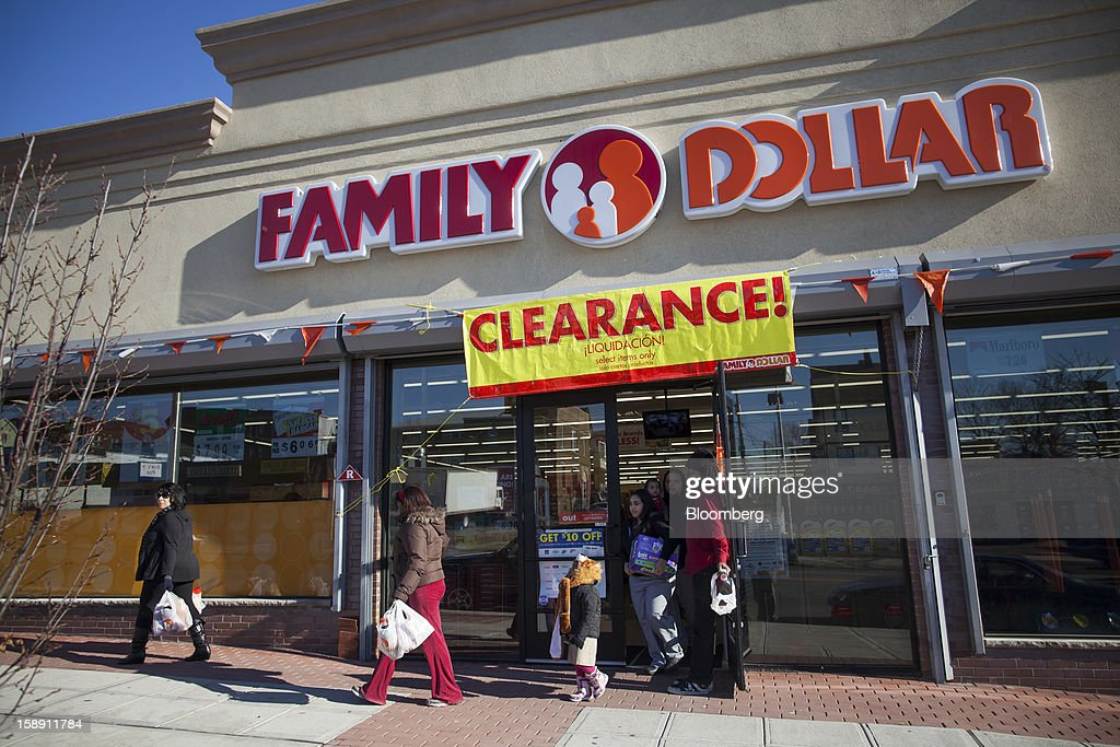 Shoppers exit a Family Dollar Stores Inc. store in Belleville, New Jersey, U.S., on Thursday, Jan. 3, 2013. Family Dollar Stores Inc., the second-largest U.S. dollar store chain, tumbled the most in more than 12 years after cutting its fiscal 2013 earnings forecast, saying consumers are reluctant to spend on more-profitable discretionary items. Photographer: Michael Nagle/Bloomberg via Getty Images