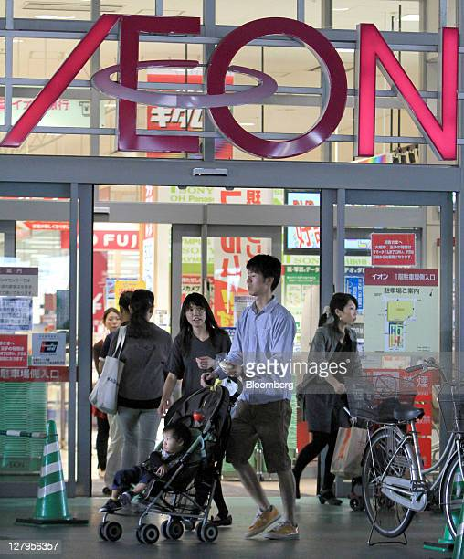 Shoppers exit an Aeon Co supermarket in Tokyo Japan on Tuesday Oct 4 2011 Aeon Co Japan's biggest supermarket operator is expected to announce...