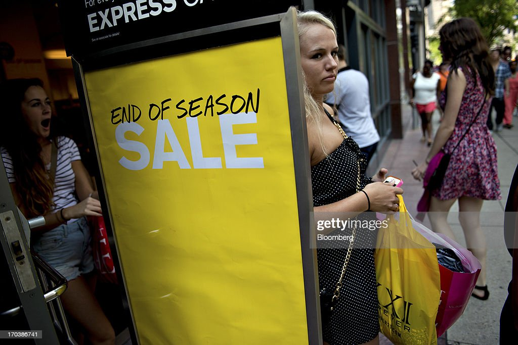 Shoppers exit an Express Inc. store in a retail area known as the 'Magnificent Mile' in Chicago, Illinois, U.S., on Tuesday, June 11, 2013. Sales at U.S. retailers probably rose in May as an improving job market gave consumers the confidence to shop for automobiles, home furnishings and clothing, economists said before reports this week. Photographer: Daniel Acker/Bloomberg via Getty Images