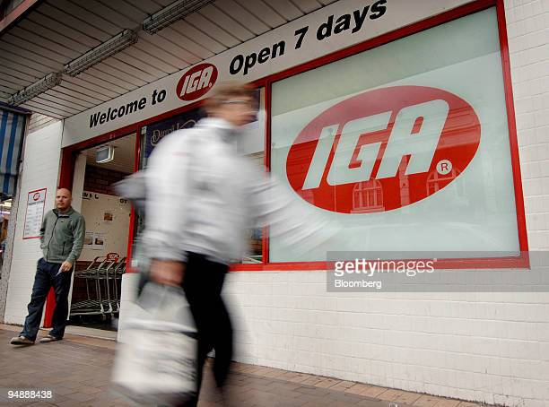 Shoppers exit an IGA supermarket in Sydney Australia on Tuesday June 3 2008 Australian consumer confidence jumped in August from a 16year low as fuel...