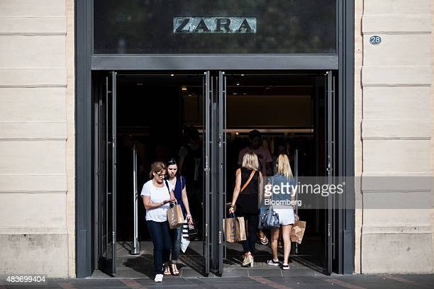 Shoppers exit and enter a Zara clothing fashion store operated by Inditex SA in Toulouse France on Tuesday Aug 11 2015 Reports on Friday will...
