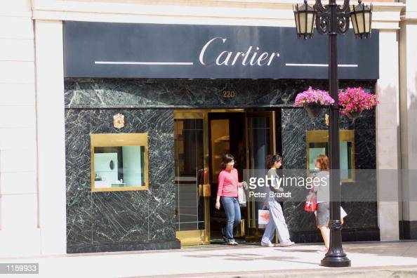 Shoppers exit the Cartier store on Rodeo Drive September 6 2001 in Beverly Hills CA