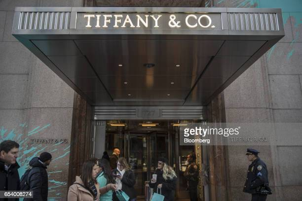 Shoppers exit the Tiffany Co flagship store on Fifth Avenue in New York US on Monday March 13 2017 Tiffany Co is scheduled to release earnings...