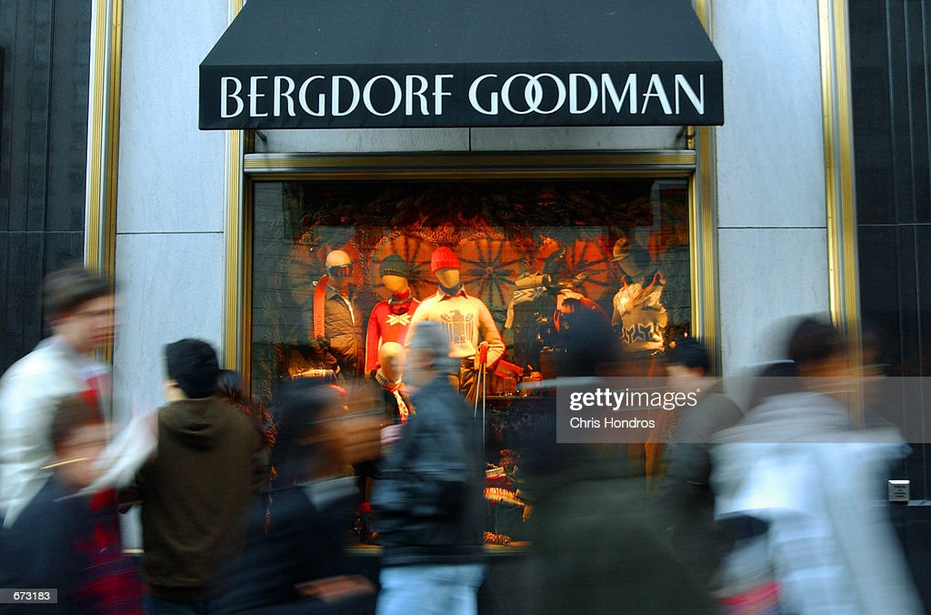 Shoppers file past the Bergdorf Goodman store on Fifth Avenue November 24 2001 in New York The retail industry has been bracing for a slow holiday...