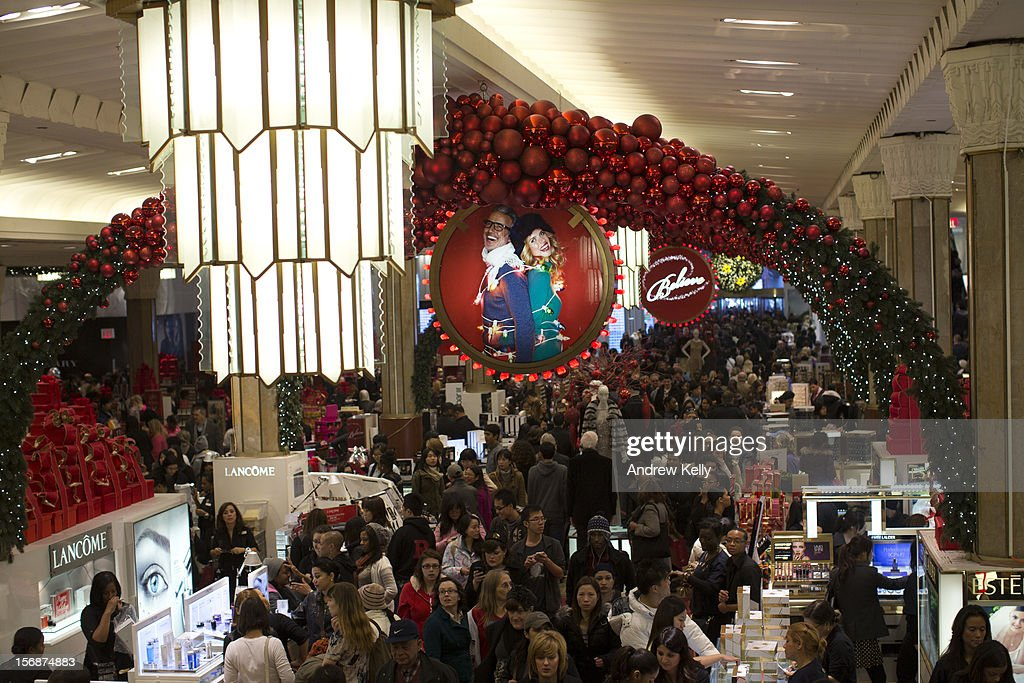 Shoppers fill Macy's during the Black Friday sales on November 23, 2012 in New York City. People filled stores in search of the many potential bargains on offer during the traditional yearly sale, which got its name as it's said to put retailers 'in the black,' or making a profit.