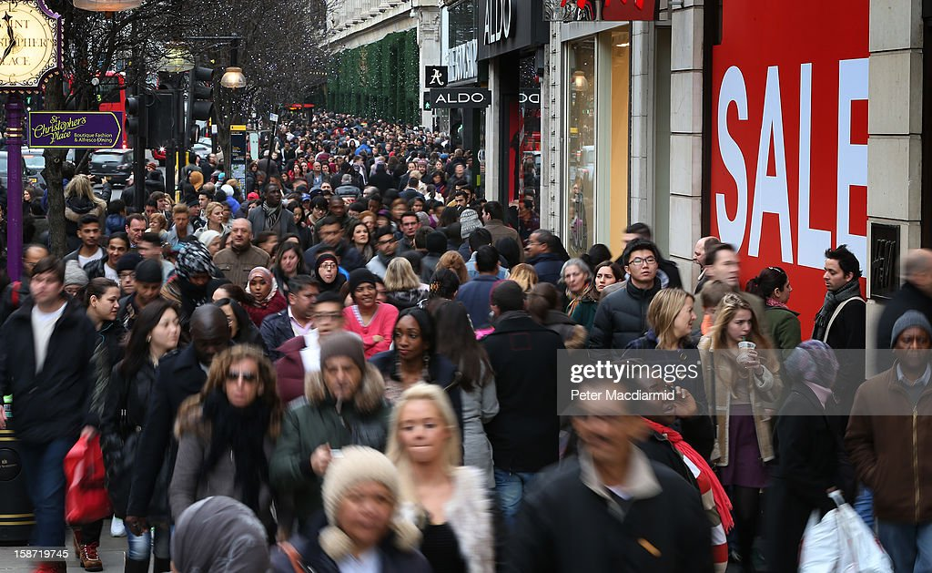 Shoppers fill Oxford Street on December 26, 2012 in London, England. Thousands of shoppers are in London looking for a bargain in the traditional Boxing Day sales.