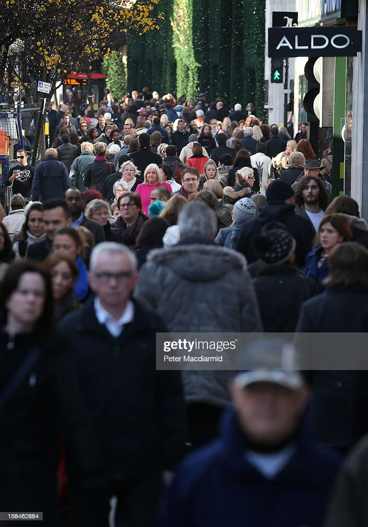 Shoppers fill the pavement near Selfridges department store in Oxford Street on December 17, 2012 in London, England. Thousands of shoppers are expected in London's west end in the hunt for Christmas bargains in the next week.