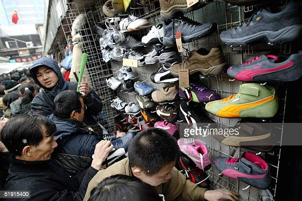 Shoppers flock to the Silk Alley market in Beijing 05 January 2005 on the last day business Beijing's outdoor Silk Alley Market a popular tourist...