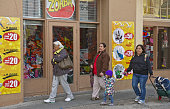 Shoppers from Nuevo Laredo Mexico walk near stores in Laredo Texas US on Monday Feb 8 2016 Mexico's peso is down 26 percent against the dollar in the...